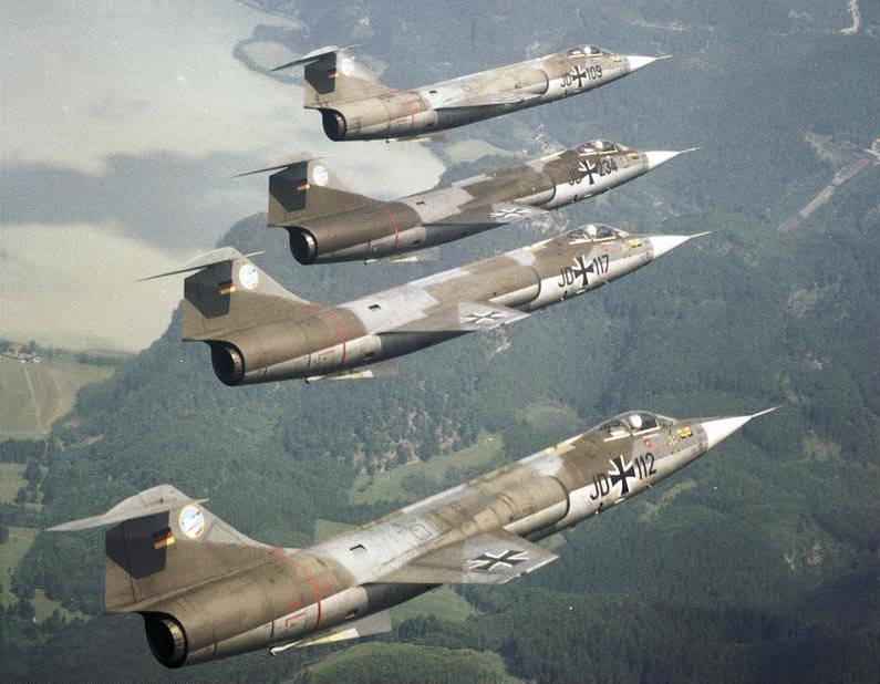"Four F-104 ""Starfighter"" flying over the Kochelsee"